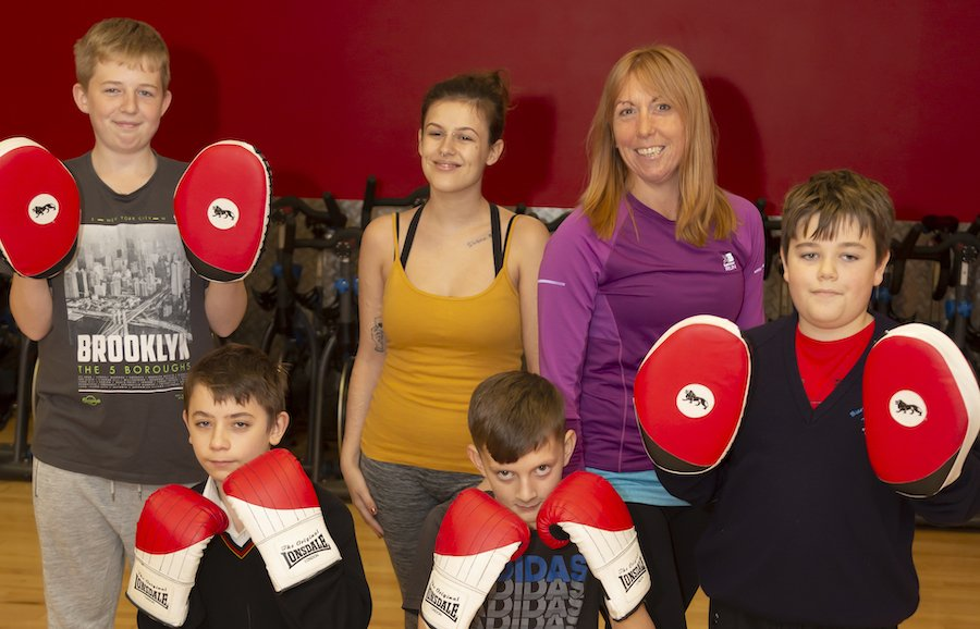 Young people posing with boxing gloves