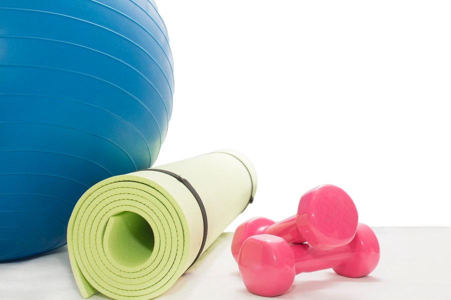 Fitness ball, mat and dumbell