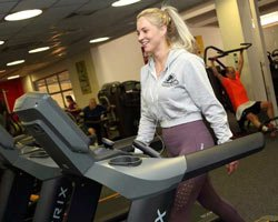 Lady on treadmill in a gym