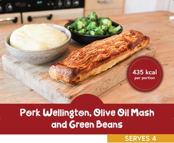 Pork wellington, olive oil mash and green beans