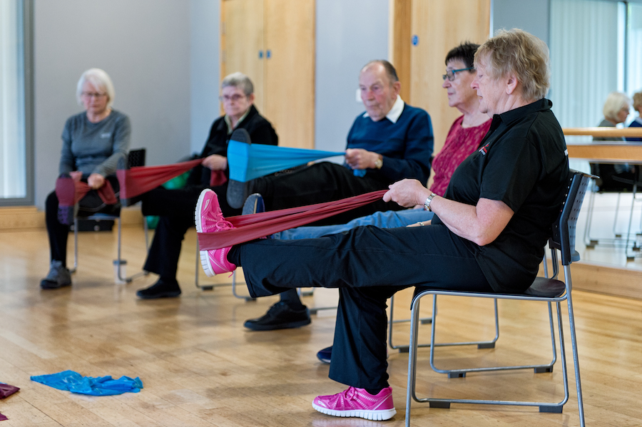 People doing chair based exercise