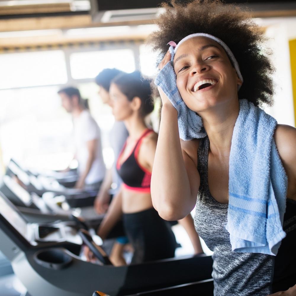 lady in gym on treadmill