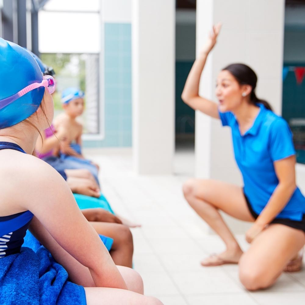 swim teacher with kids