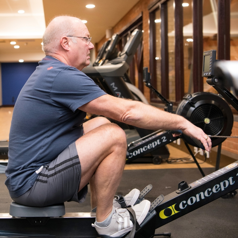 Man in gym on rower