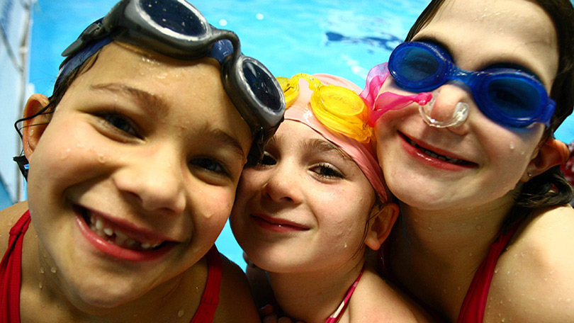 3 girls in a pool - close to camera