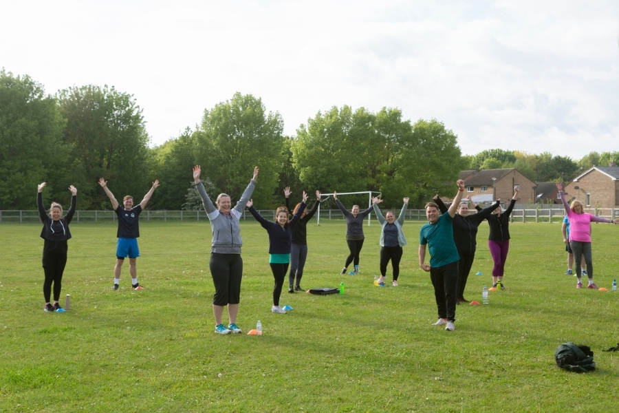 group doing exercise outdoors