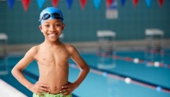 little boy by side of pool