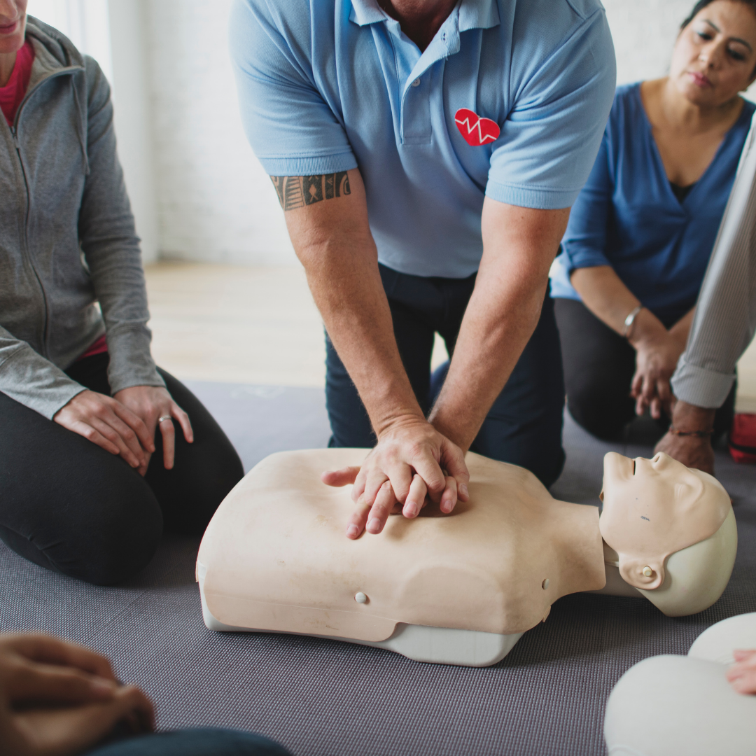 First aid. Dummy being given compressions