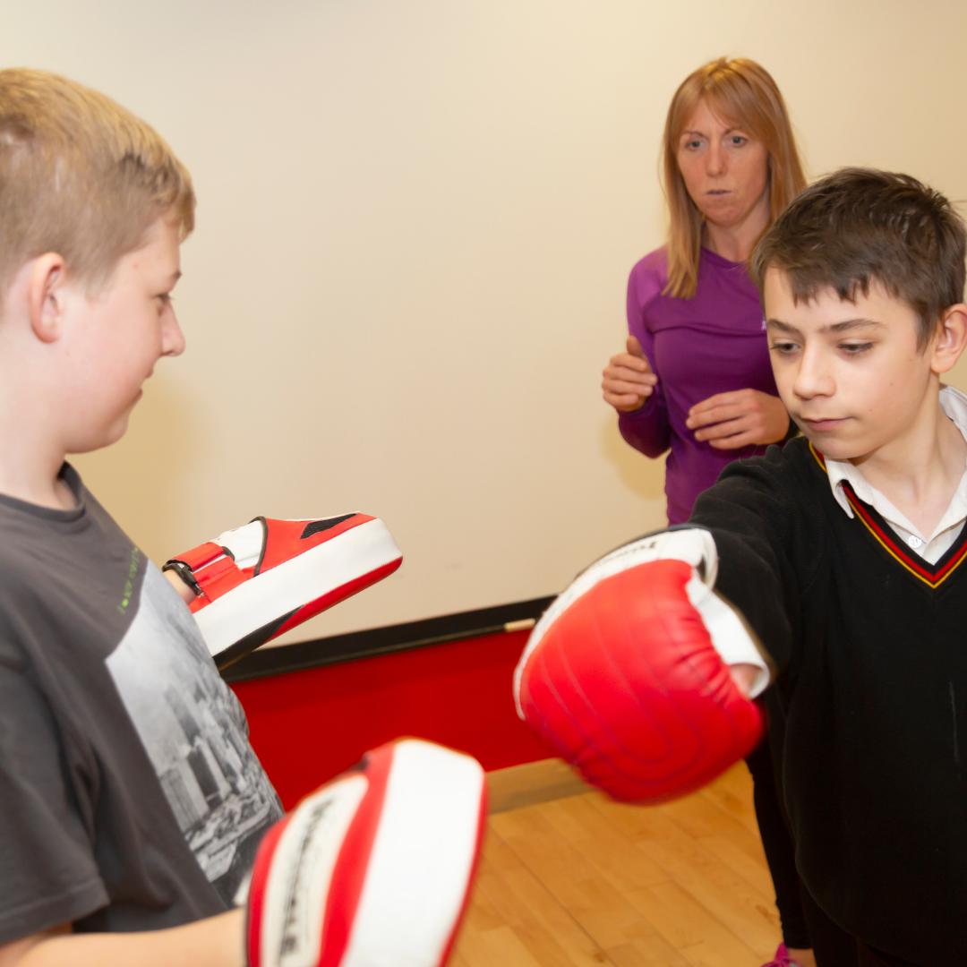 Children doing light boxing exercises