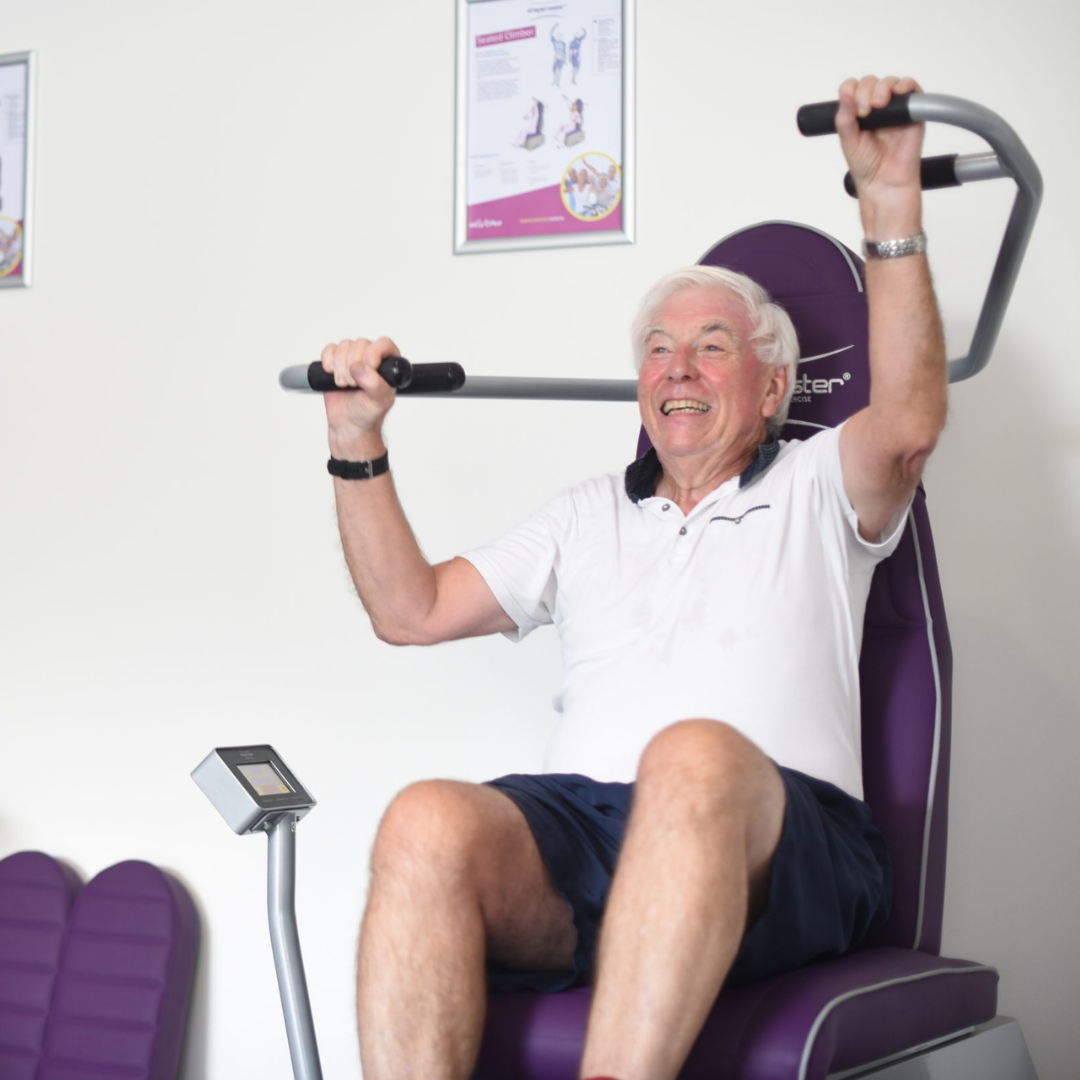 Older man exercising with Wellbeing Hub equipment