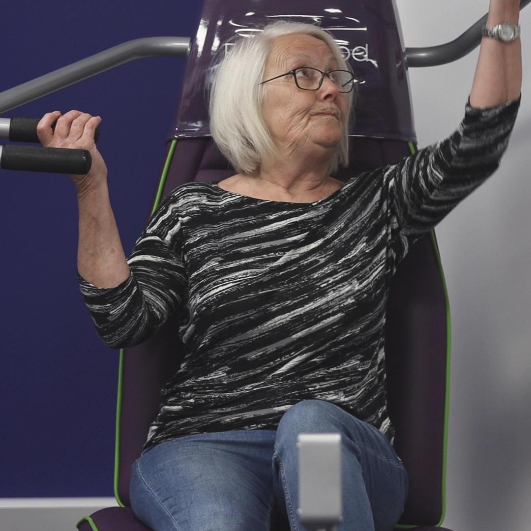 Older woman using shapemaster equipment
