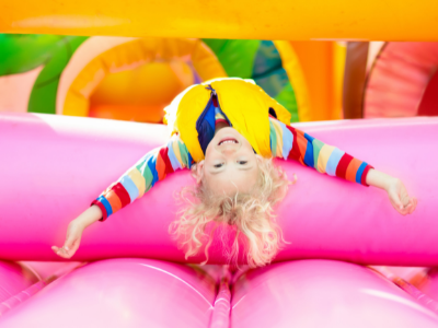 child on bouncy castle- party